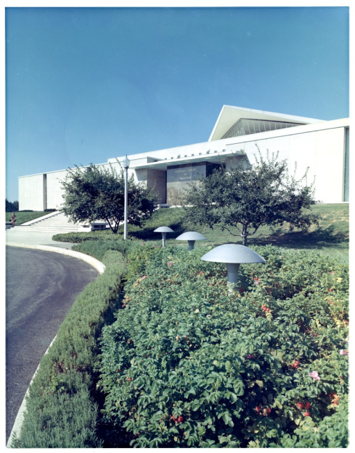 <p>Trees, shrubbery and landscaping outside the main west entrance to building #38, the National Library of Medicine.</p>