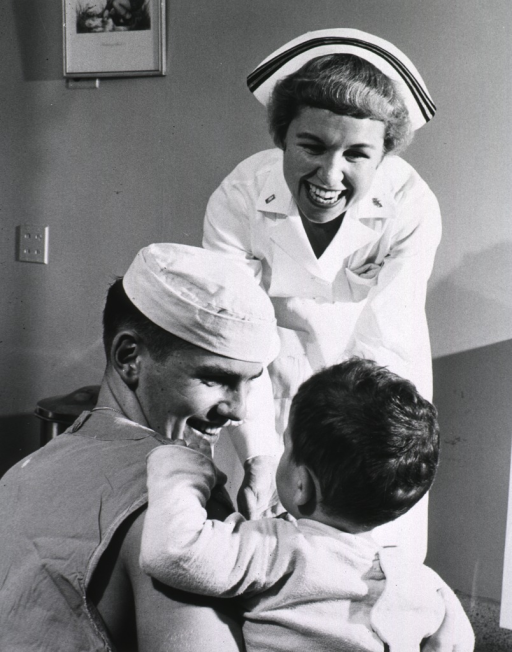<p>Nurse and hospital corpsman in children's ward.</p>