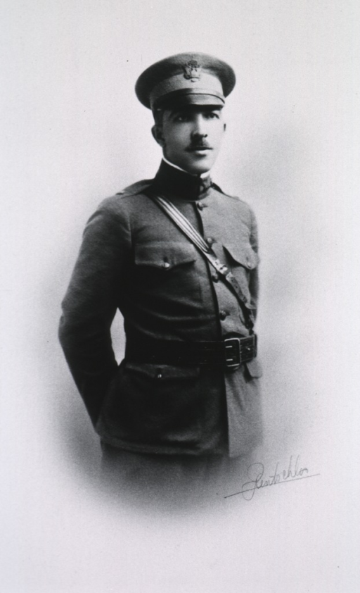 <p>Standing, right pose; hands behind back.  In uniform and cap.</p>