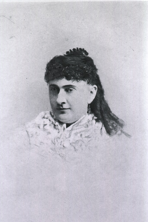 <p>Shown as a younger woman with curls and high comb.</p>