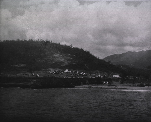 <p>View of Siboney after the houses were burned, showing Camp of U.S. Enginners.  The path over the hill is the one the &quot;Rough Riders&quot; passed in going to the front.  Lieut. Capron was killed just on the other side of the hill.</p>