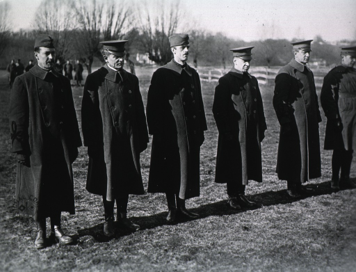 <p>All standing, full length; wearing coats and hats.</p>