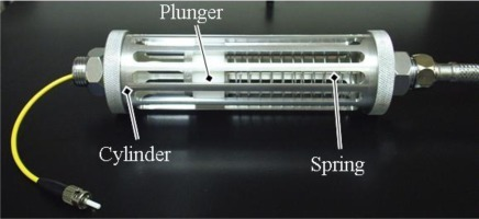 Picture of an encapsulation device designed for fiber-based sensors in aqueous environments.