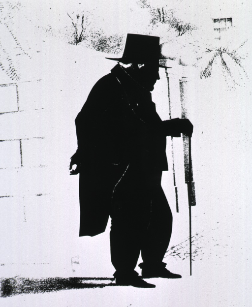 <p>Silhouette, full length, standing, leaning on cane, right profile.</p>