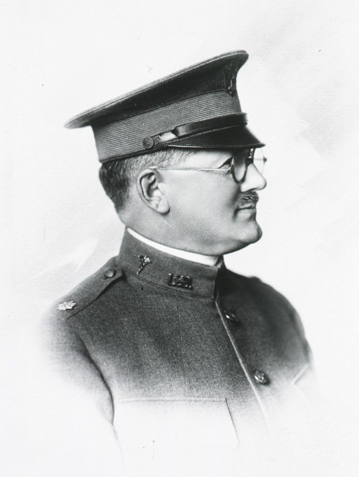 <p>Head and shoulders, right profile, in uniform and cap.</p>
