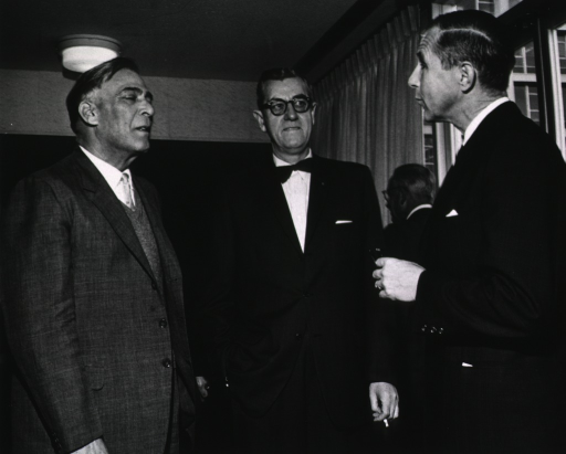 <p>Lieut. Gen. W.A. Burki, Dr. James Shannon, and Dr. Theodore E. Woodward talk together during Lt. Gen. Burki's visit to NIH.</p>