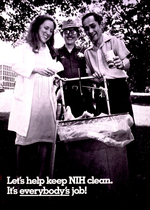<p>A woman and two men are standing behind a full garbage can.  Two of the people are tossing paper cups in the trash.  A stick for picking up papers leans against the can.</p>