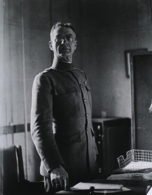 <p>Half-length, standing at desk, right pose, full face; wearing uniform and glasses.</p>