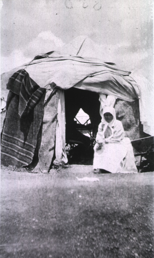 <p>A nurse sits outside her tent at the Vitebsk Red Cross Hospital.</p>