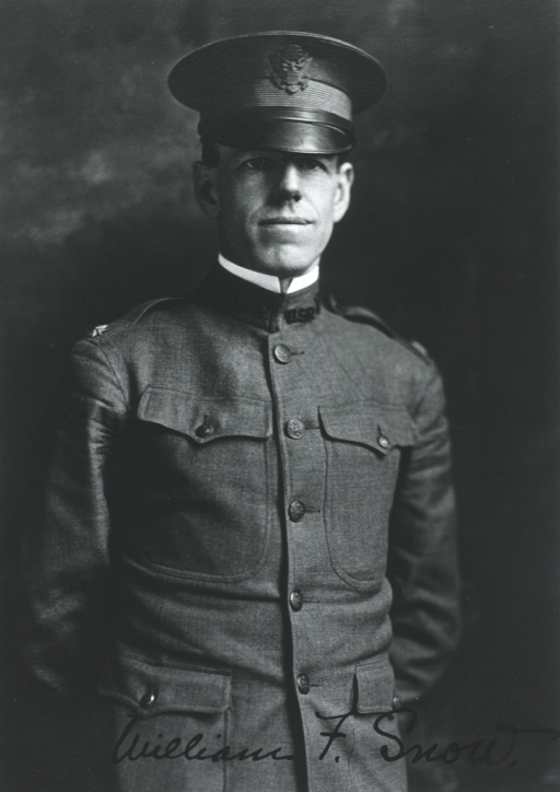 <p>Standing, three quarter length, in uniform and cap.  Arms clasped behind back.</p>