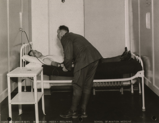 <p>Patient and physician illustrating the Schneider Index, a cardio-vascular efficiency test.</p>
