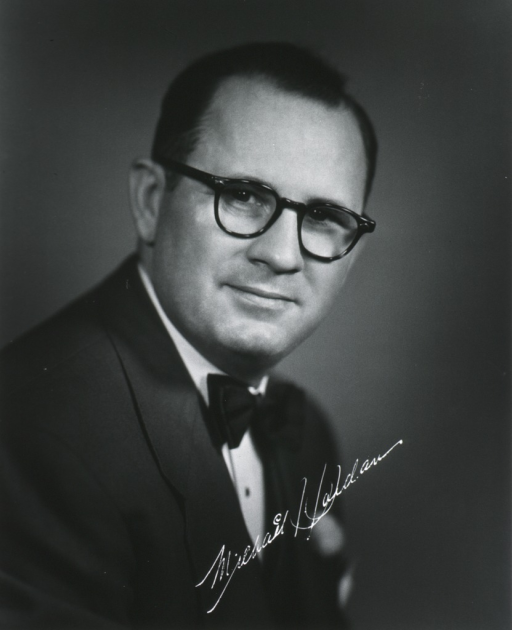 <p>Head and shoulders, right pose, full face; wearing glasses.</p>