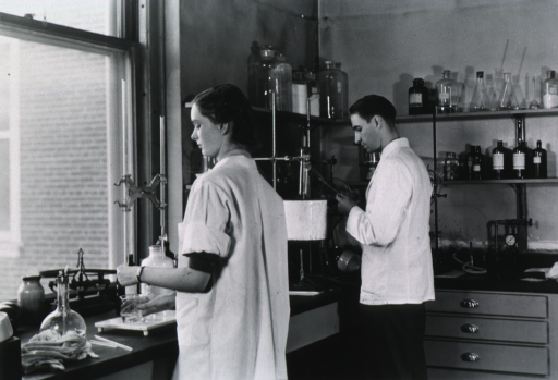 <p>Three quarter length, standing, in laboratory.</p>