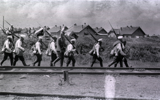 <p>Soldiers walking along railroad tracks at Gungalin.  They have just arrived.</p>
