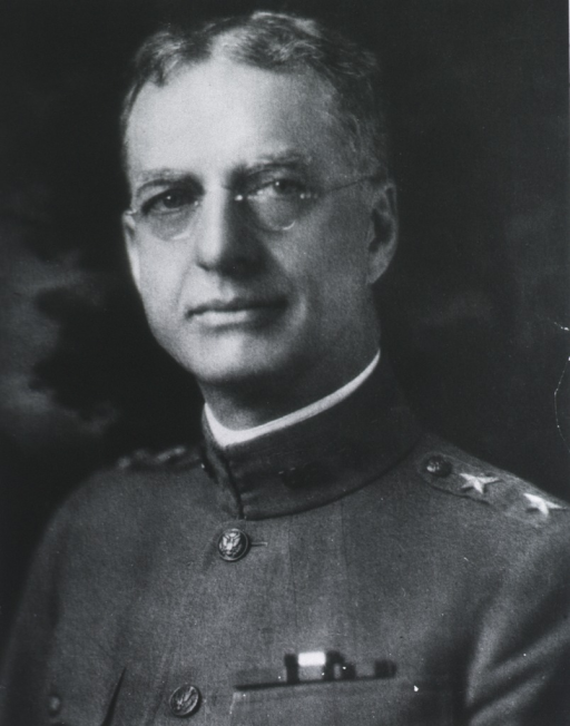 <p>Head and shoulders, left pose, full face; wearing uniform and glasses.</p>
