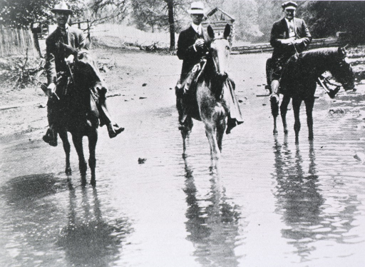 <p>On horseback with two other doctors.</p>