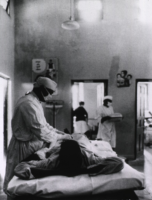 <p>Interior view of operating room: a patient is lying on a bed during a vasectomy operation.</p>