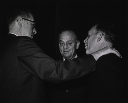 <p>Showing a brief conference between Dr. James A. Shannon, Dr. Luther Terry, and Dr. Seymour Kety.</p>