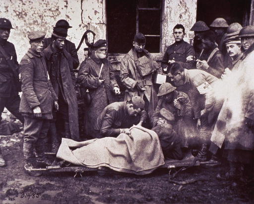 <p>Lieutenant C.S. Darley, a Catholic chaplain, administers to a German officer lying on a stretcher outside a building; a group of soldiers are gathered around them, including three with Red Cross armbands.</p>