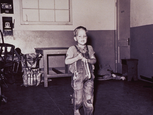 <p>A little boy is playing with a hobbyhorse.</p>