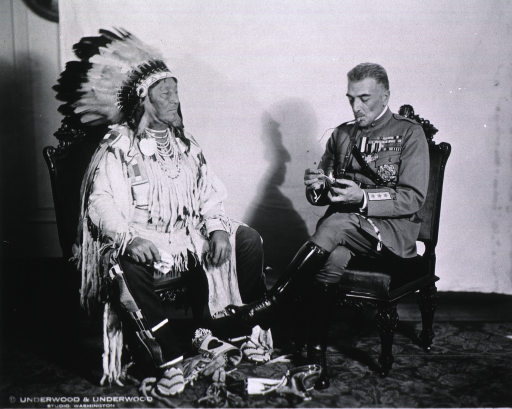 <p>Full length portrait of Diaz and Indian Chief, seated, smoking peace pipe.</p>