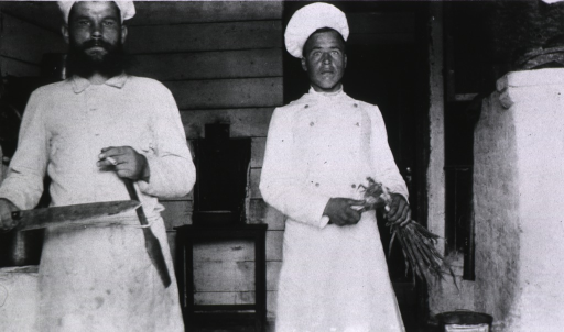 <p>Two kitchen workers in the pantry of Military Hospital No. 16.</p>
