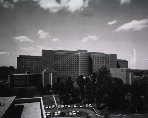 <p>View of the back entrance to the Clinical Center, showing the Blood Bank and the Surgical Wing on the left.</p>