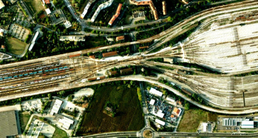 Example of a technological structure organized as a bow tie. Aerial view of the Bologna freight marshalling yard, clearly showing a structure analogous to a bow tie. Wagons arrive from a variety of sources (left bow); to facilitate control and sorting out operations, they are driven through a narrowing: few rails under strict supervision to ensure the maximal capability for control and decision-making; from here they are dispatched to a plethora of new destinations (right bow). Again, the narrowing (the 'core' surveillance station) allows economical and effective regulation to be taken and exercised on a variety of inputs (train provenances) and to yield a quantity of outputs (new destinations). Inspired by Needham [122], p. 170, Figure forty five. Image from Google Maps.
