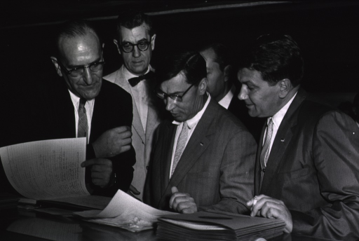 <p>Dr. James A. Shannon and Dr. Jack Masur meet with Soviet visitors as they sign the guest register at the Clinical Center on Sept. 25, 1959.  Shown with Drs. Shannon and Masur are Dr. Aleksandra M. Markov and Dr. Valeri N. Butrov.</p>