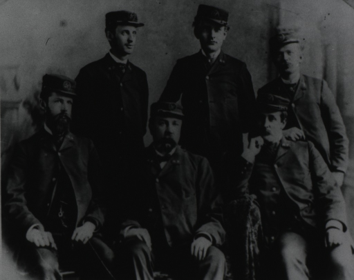 <p>Six men are posed sitting and standing; they are wearing the first uniform of the Public Health Service, ca. 1878.</p>