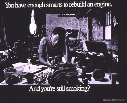 <p>Black and white poster with white lettering.  Title at top of poster.  Visual image is a b&amp;w photo reproduction featuring a teenage boy leaning over a table that is strewn with car parts.  A car in the background has its hood raised.  The teen looks up at the camera and holds a lit cigarette in one hand.  Caption below photo.  Publisher information in lower right corner.</p>