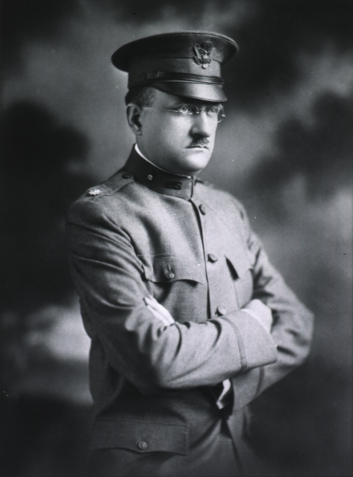 <p>Standing, 3/4 length in uniform.  Arms folded.</p>