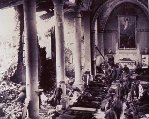 <p>Interior view of a bombed-out church: many soldiers lay on stretchers on the floor; other soldiers move about, some tend the wounded; gaping holes in the walls of the church; a large painting hangs over alter; a small dog stands among the rubble.</p>