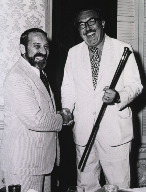 <p>Both standing, three-quarter length; Wolff receiving the K.F. Meyer Gold-Headed Cane Award from Steele.</p>