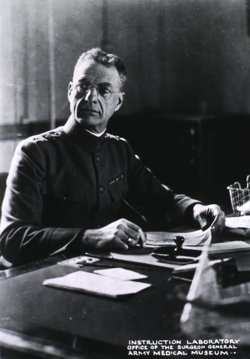 <p>Head and shoulders, seated at desk, right pose, full face; wearing uniform.</p>