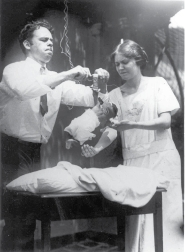 Curt Richter and Phyllis Greenacre conducting an experimental study of the grasp reflex in human infants. (Reproduced by courtesy of the Alan Mason Chesney Medical Archives, Johns Hopkins Medical Institutions.)