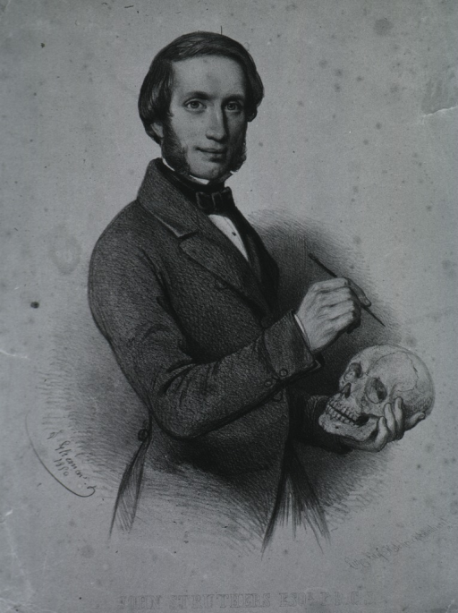 <p>Standing demonstrating, with skull.</p>