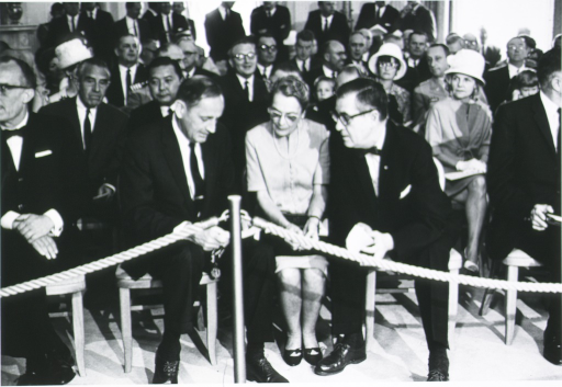 <p>Secretary of DHEW John Gardner talks with Dr. and Mrs. James A. Shannon after receiving Presidential Distinguished Federal Civilian Service Award.  Shown seated behind Gardner and the Shannons are Averil Harriman and Dan Inouye.</p>
