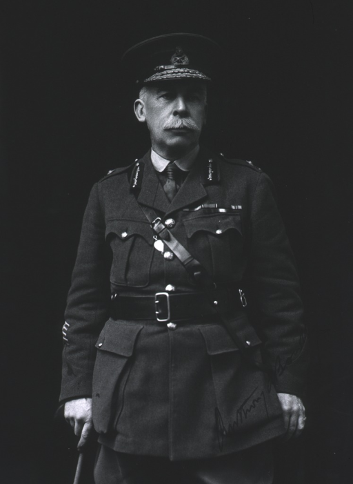 <p>Standing, left hand in pocket and right hand resting on cane, wearing full army uniform.</p>