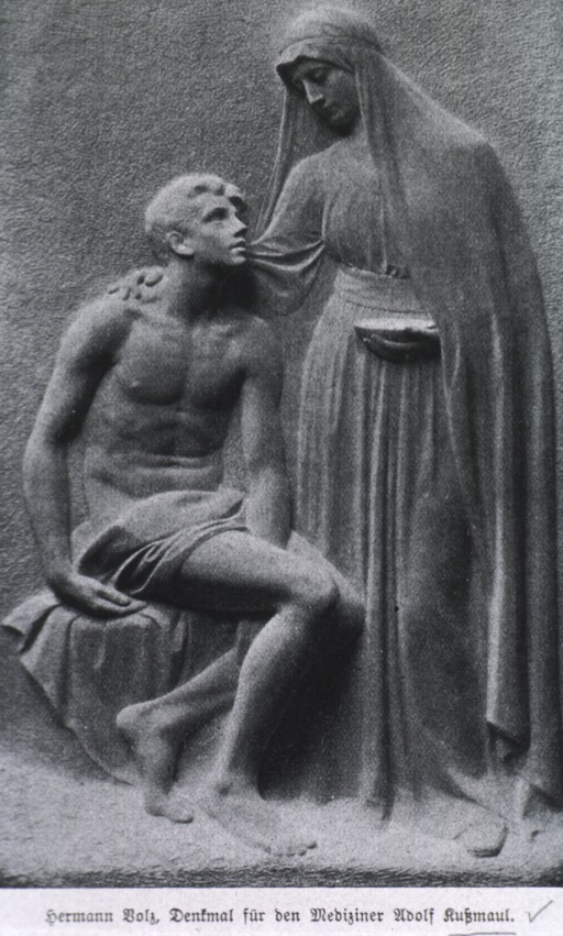 <p>Memorial monument; one figure seated, one standing.</p>