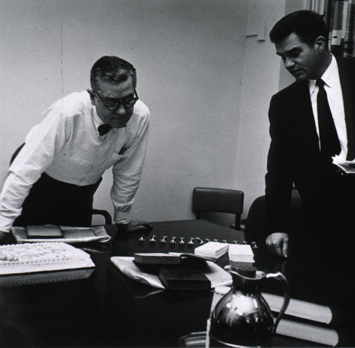 <p>Dr. Shannon examines memorabilia presented to him by Dr. Stuart M. Sessoms to commemorate his 10th anniversary as Director of NIH.  Items shown are a bound collection of Dr. Shannon's articles and speeches and a first edition of the U.S. Pharmacopeia.</p>