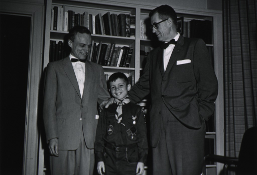 <p>Dr. James A. Shannon is the recipient of a Boy Scout emblem, presented by Cub Scout Peter M. Lynch, in recognition of Scouting's Golden Jubilee Year.  Also shown is Peter's father, Dr. John M. Lynch.</p>