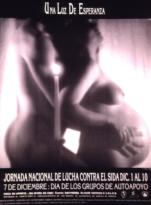 <p>A naked man and pregnant woman are behind a lighted candle.</p>