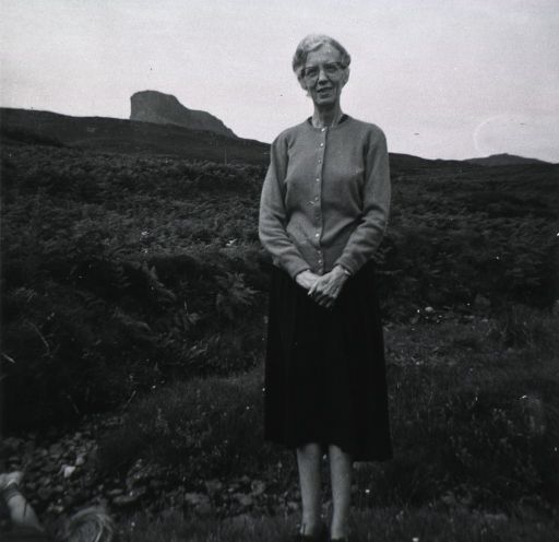 <p>Standing, full-length, in a field.</p>