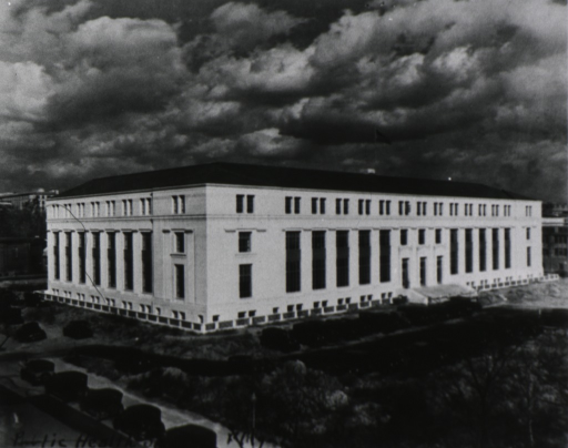 <p>Bird's-eye view of front and left side facades of the PHS building; many cars parked in front and to the left of the building.</p>