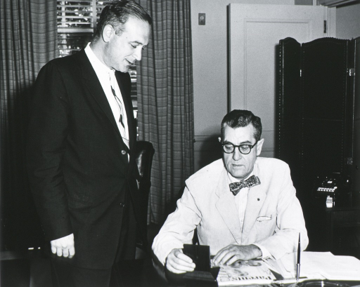 <p>Dr. James A. Shannon examines Parents' Magazine Medal presented to him by Robert S. Cramer on Septemper 29, 1959, &quot;in recognition of the vital role which NIH plays in the physical and mental well-being of America's families.&quot;</p>
