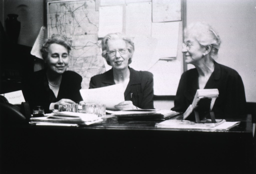 <p>Head and shoulders, all three seated behind the same desk.</p>