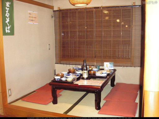 Tatami mats, woven from rice straw, have a standard size of 90 cm X 180 cm.  In this Kyoto restaurant, the customers sit on tatami mats, either cross-legged or on their knees.