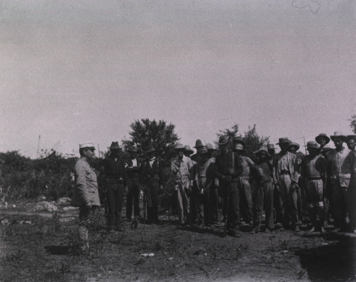 <p>Soldiers escort Spanish prisoners back to their camp.</p>