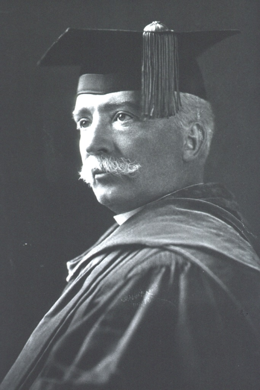 <p>Head and shoulders, left pose; wearing academic cap and gown.</p>